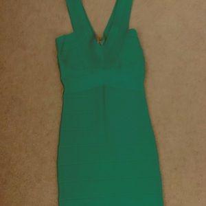 bebe Dresses - Emerald green bandage dress
